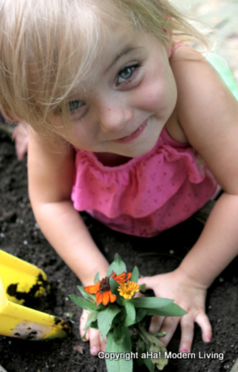 little girl planting-aha-1